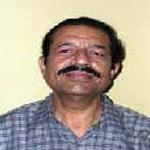 Dr. V.K. Tandon Member
